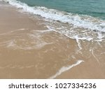 sea wave with bubbles hits the... | Shutterstock . vector #1027334236