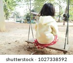 little baby sitting swing home...   Shutterstock . vector #1027338592