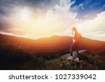 tourist girl with backpack... | Shutterstock . vector #1027339042