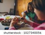 two girls enjoying in easter... | Shutterstock . vector #1027340056