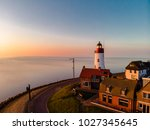 sunset sky by the lighthouse of ... | Shutterstock . vector #1027345645
