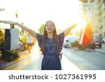 happy woman holding shopping... | Shutterstock . vector #1027361995