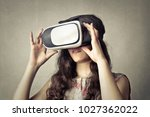 woman using 3d glasses | Shutterstock . vector #1027362022