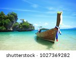 long tail boat by the shore at...   Shutterstock . vector #1027369282