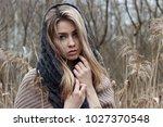 beautiful sad girl is walking... | Shutterstock . vector #1027370548