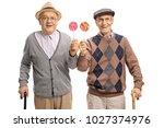 seniors with lollipops isolated ...   Shutterstock . vector #1027374976