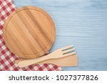 cutting board with tablecloth... | Shutterstock . vector #1027377826