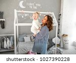 mom and daughter are at home in ... | Shutterstock . vector #1027390228