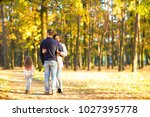 mom and dad with daughter at... | Shutterstock . vector #1027395778