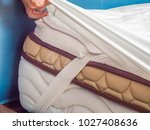 woman is putting the bedding... | Shutterstock . vector #1027408636