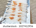 hot maple syrup on a stick in... | Shutterstock . vector #1027412956