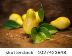 fresh pears on a wooden... | Shutterstock . vector #1027423648
