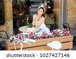 attractive happy young woman... | Shutterstock . vector #1027427146