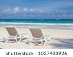 two white beach chairs on the... | Shutterstock . vector #1027433926