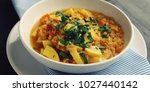 red lentil stew with potato ... | Shutterstock . vector #1027440142