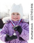 Small photo of The first award in a sports career. Little girl was awarded a medal for winning a sports match.
