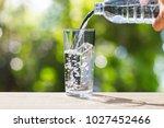 hand holding drinking water... | Shutterstock . vector #1027452466