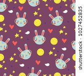 colorful pattern with bunnies... | Shutterstock .eps vector #1027452835