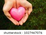 hands holding heart   Shutterstock . vector #1027467076