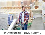 man chooses and buys wooden... | Shutterstock . vector #1027468942