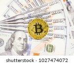 golden bitcoin cryptocurrency... | Shutterstock . vector #1027474072