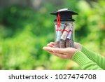 woman hand holding coins money...   Shutterstock . vector #1027474708