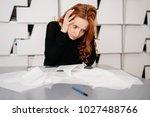 frustrated businesswoman... | Shutterstock . vector #1027488766