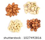 mixed of nuts heap isolated on... | Shutterstock . vector #1027492816