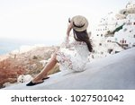 happy woman in white dress and... | Shutterstock . vector #1027501042