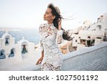 happy woman in white dress and... | Shutterstock . vector #1027501192