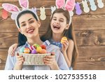 happy holiday  mother and her... | Shutterstock . vector #1027535518