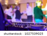 people dancing at a party or... | Shutterstock . vector #1027539025
