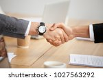 close up view of handshake  two ... | Shutterstock . vector #1027563292