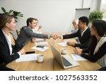 diverse businessmen shaking... | Shutterstock . vector #1027563352