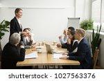 successful female boss leading... | Shutterstock . vector #1027563376