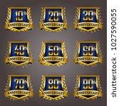 set of gold anniversary badges... | Shutterstock .eps vector #1027590055