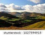 autumn sunlight onthe... | Shutterstock . vector #1027594915