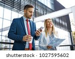 young business people are... | Shutterstock . vector #1027595602