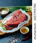 raw beef meat on a wooden... | Shutterstock . vector #1027595782