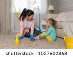 mom and daughter are cleaning... | Shutterstock . vector #1027602868