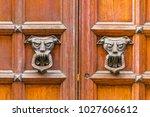 door knockers on ancient wooden ... | Shutterstock . vector #1027606612