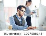 bearded businessman in... | Shutterstock . vector #1027608145