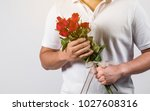 men are giving roses to... | Shutterstock . vector #1027608316