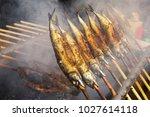 marinated grilled mackerels on... | Shutterstock . vector #1027614118