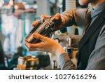 barman in pub holding shaker....   Shutterstock . vector #1027616296