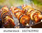 bbq meat prepare on fire  | Shutterstock . vector #1027625902