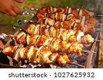 bbq meat prepare on fire  | Shutterstock . vector #1027625932