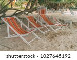a bunch of lounge chairs on the ...   Shutterstock . vector #1027645192