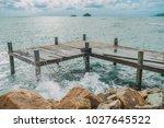 wooden pier in the sea.    Shutterstock . vector #1027645522