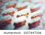 pills in dark style. macro... | Shutterstock . vector #1027647106